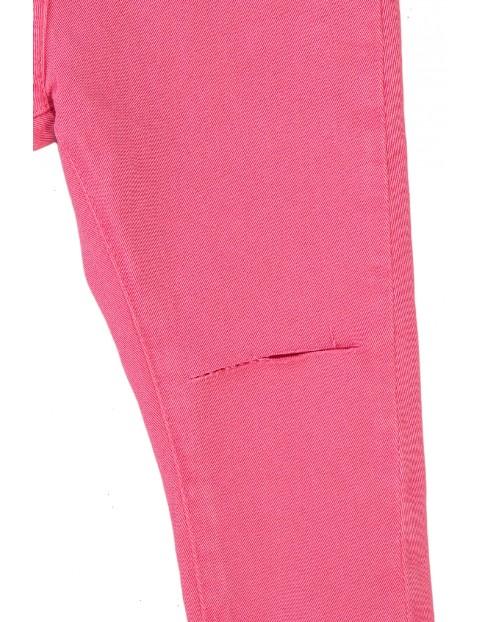 Spodnie dziewczęce w kolorze różowym z rozcięciami na kolanach
