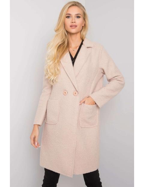 Różowy damski płaszcz z kieszeniami