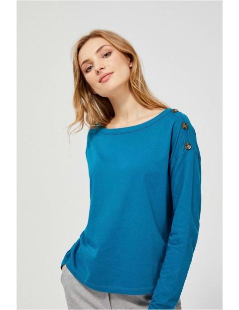 Niebieska bluzka damska z guzikami na ramionach