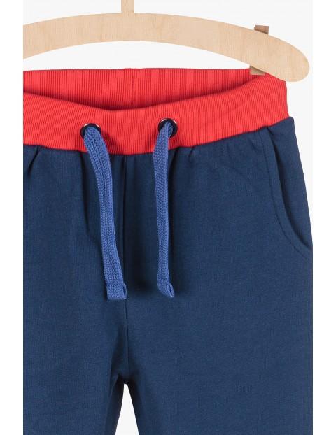 Spodnie dresowe chłopięce - granatowe